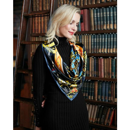 Model standing in a library wearing a Patrick Francis Book of Kells silk scarf